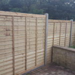 After picture. Prolap fence panels on concrete posts and concrete gravelboards.