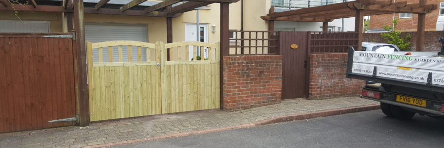 Curved top driveway entrance gates