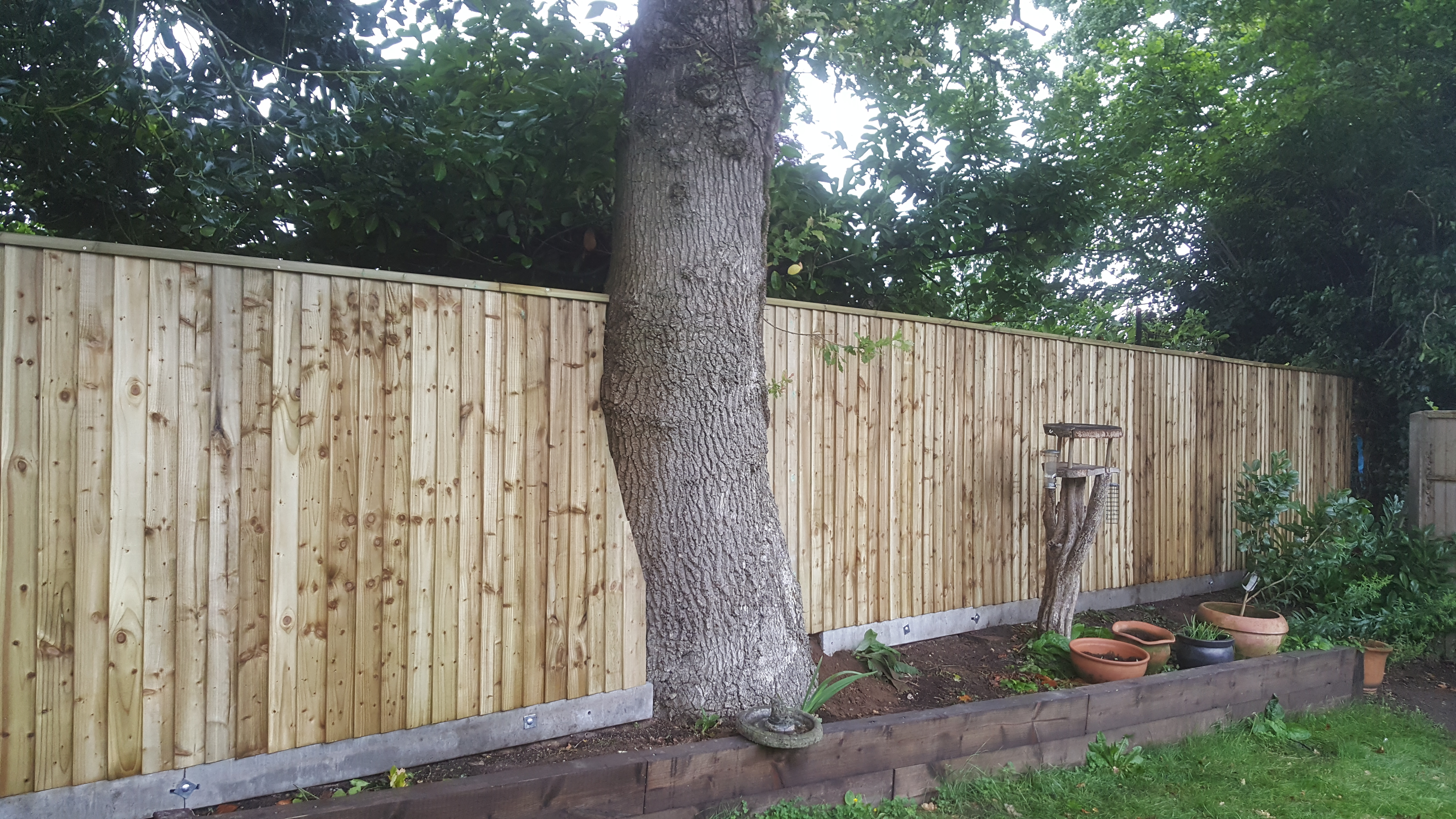 Closeboard Fencing Installed On Concrete Universal Posts