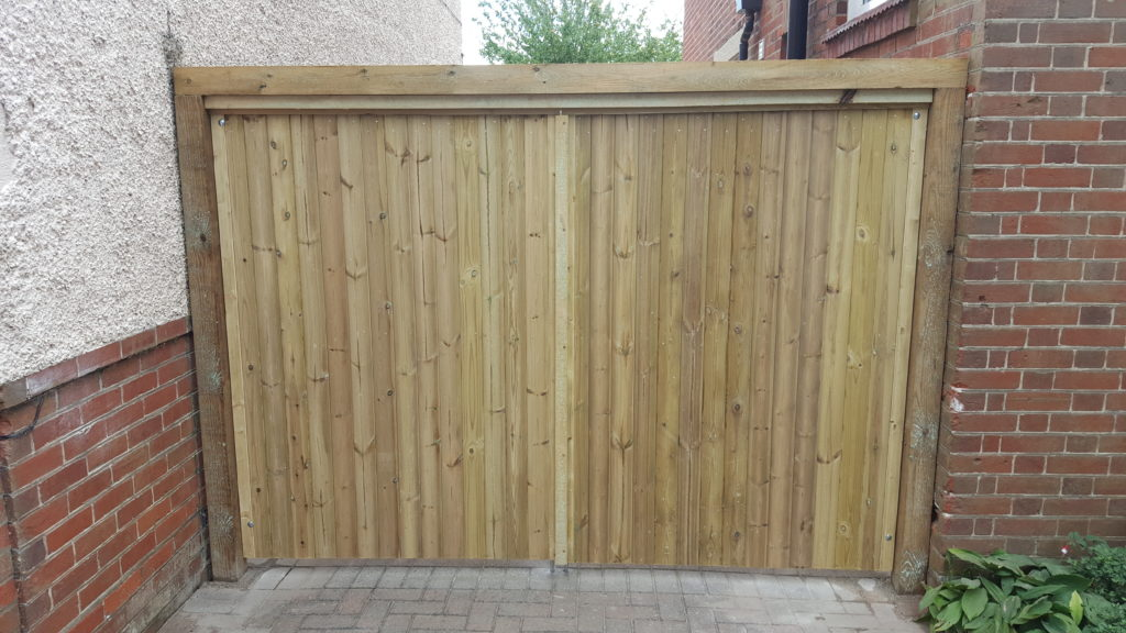 Bespoke gates fitted with overhead bracing beam