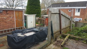 Before photo. Showing old fence and boltdown post.