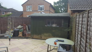 12x 8 ft shed. Needs to be removed and disposed of befor a new base and shed can be built.