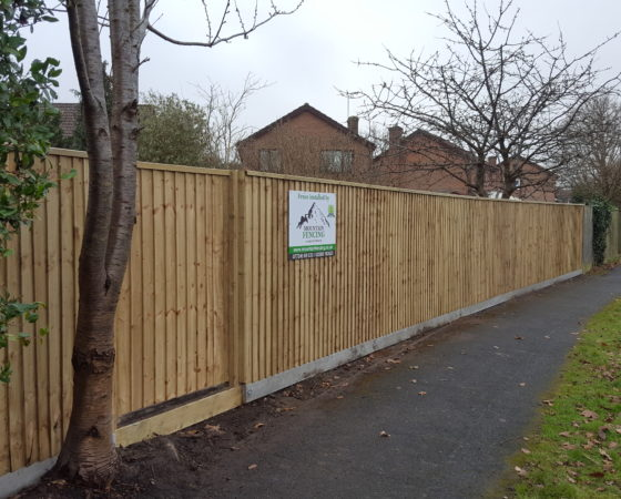 Closeboard fencing on recessed concrete posts and concrete gravelboards