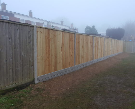 Closeboard fencing on concrete posts and twin concrete gravelboards