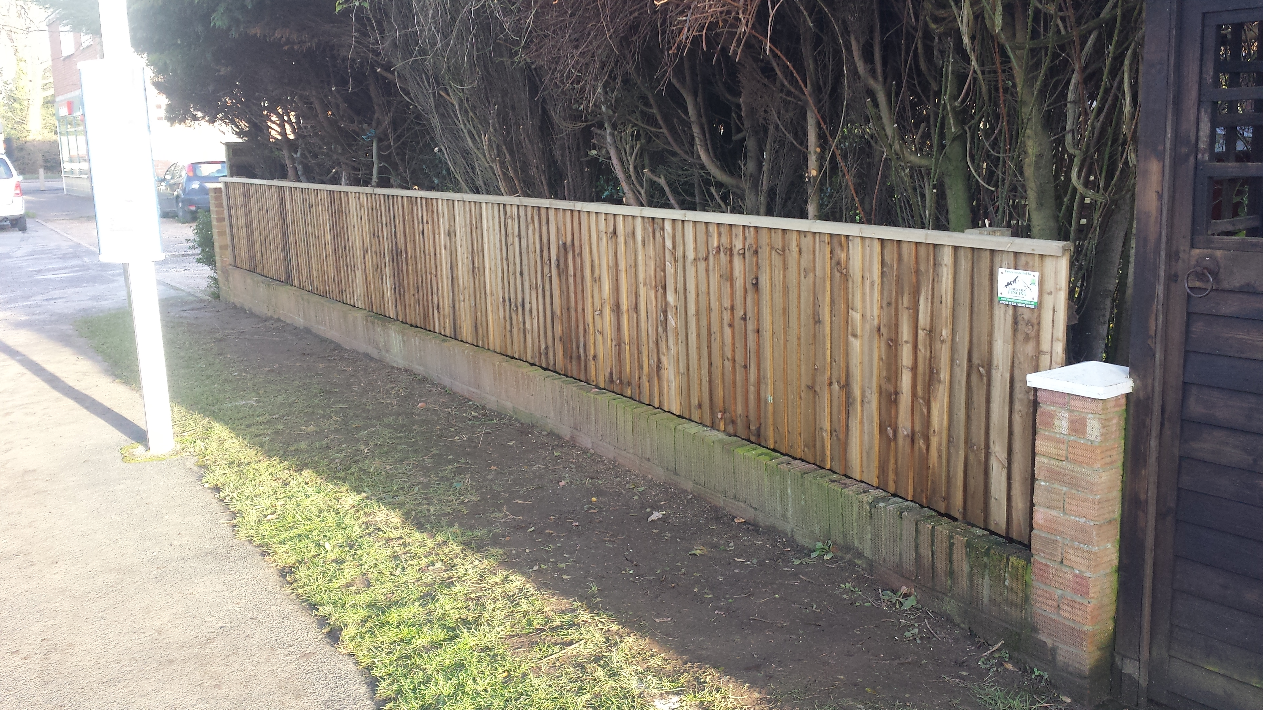 Closeboard fencing on wooden posts and bevelled rails
