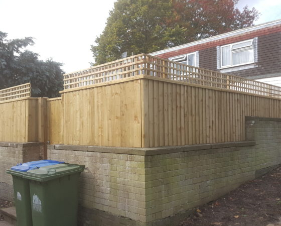 Closeboard fencing installed on top of existing wall. 1ft trellis on top to add extra privacy