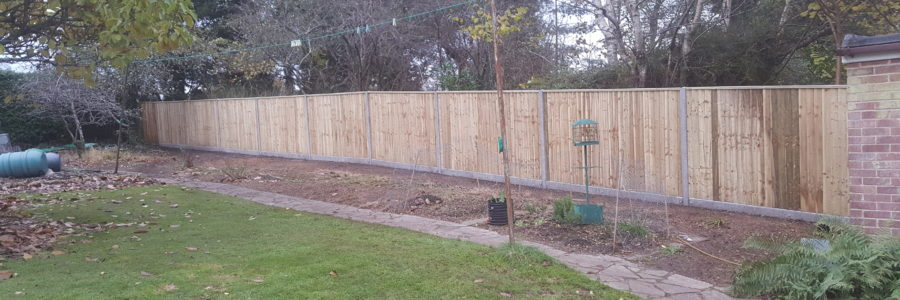 Closeboard fencing on concrete posts and concrete gravelboards